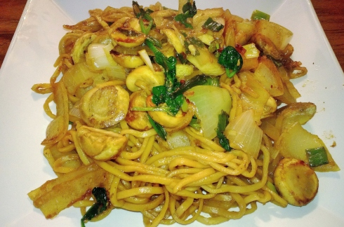 Chinese egg noodles stir fry with spring onions, honey, mushrooms and spinach